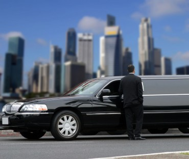 2341234 - limousine driver waiting for passenger in singapore